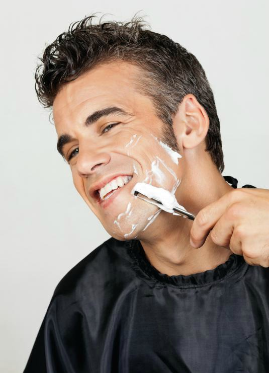 man-shaving-his-face-with-razor
