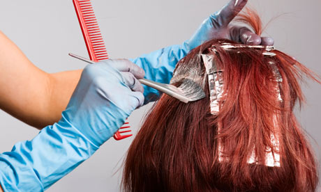 Hairdresser applying colour to customer's hair
