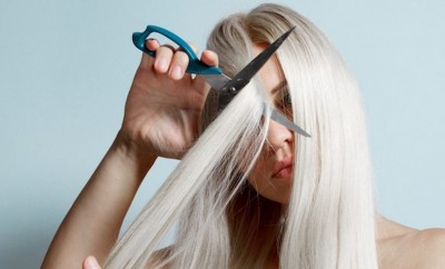 woman-cutting-long-blond-hair
