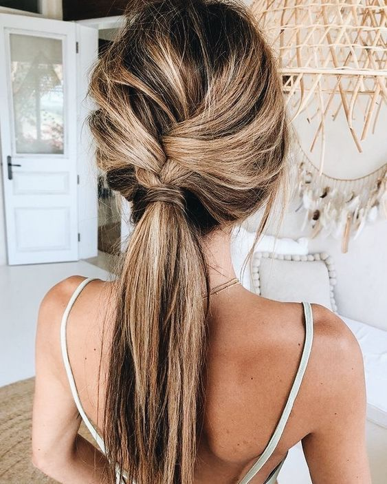 02-a-loose-braid-into-a-ponytail-is-a-cool-idea-for-a-boho-or-rustic-wedding