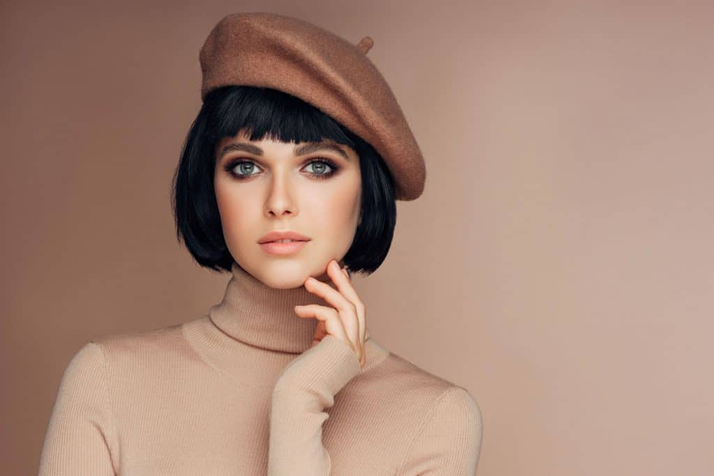 A-woman-with-a-French-bob-hairstyle-with-a-beret-on-her-head-1024x683